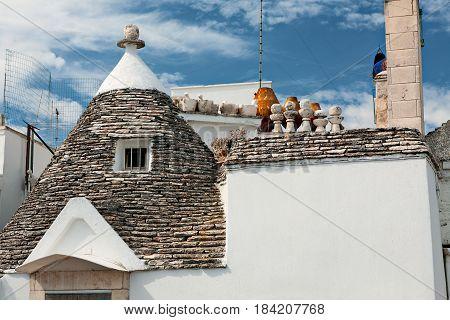 Roof of a Trullo house in Alberobello under a blue sky Puglia Italy