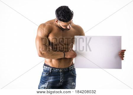 Naked young male bodybuilder holding blank white sign, isolated on white background, large copyspace