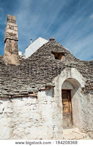 Old Trullo house under a blue sky in Alberobello Puglia Italy