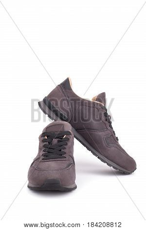 Suede sneakers isolated on white background .