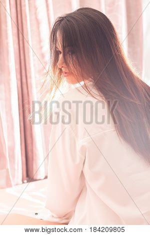 Portrait of beautiful Asian woman sit on the bed in the morning