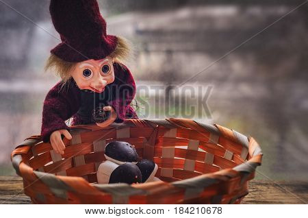 Wicker basket with sweet marshmallow And cheerful toy
