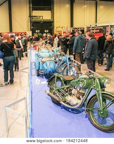 St. Petersburg Russia - 15 April, A number of Soviet-era motorcycles,15 April, 2017. International Motor Show IMIS-2017 in Expoforurum. Visitors and participants of the annual moto-salon in St. Petersburg.