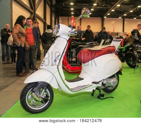 St. Petersburg Russia - 15 April, White retro scooter,15 April, 2017. International Motor Show IMIS-2017 in Expoforurum. Motorcycles and motoconcepts presented at St. Petersburg Motor Show.