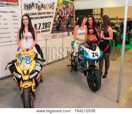 St. Petersburg Russia - 15 April, Young participants of the motor show,15 April, 2017. International Motor Show IMIS-2017 in Expoforurum. Models on motorcycles presented at the motor show.