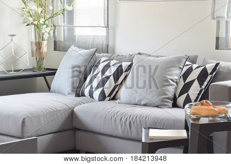 Black And White Parallelogram Pattern Pillows On Gray Comfy Sofa