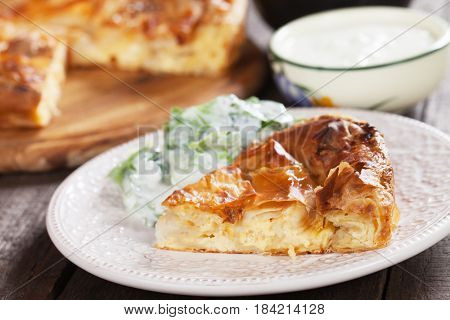 Phyllo pastry cheese pie served with yogurt and salad