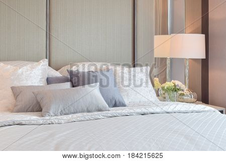 Classic Bedroom Interior With Pillows And Reading Lamp On Bedside Table
