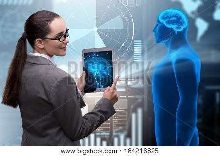 Futuristic remote diagnostics concept with businesswoman