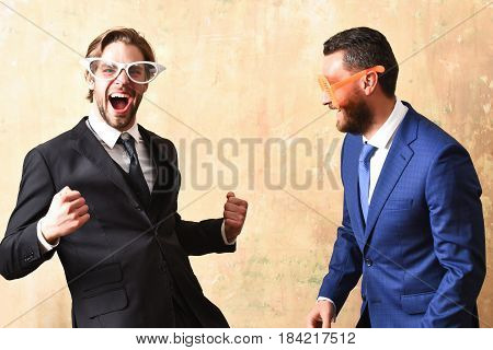 Business Success Concept. Businessmen In Suits And Funny Glasses Celebrating Deal