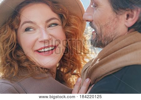I am so happy. Portrait of joyful senior woman is enjoying hug of her boyfriend. She is smiling