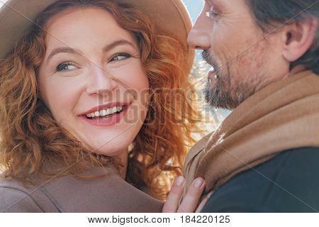 I am so happy. Portrait of joyful senior woman is enjoying hug of her boyfriend. She is smiling