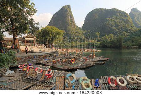 YANGSHOU CHINA - NOVEMBER 17, 2016: Unidentified people work at bamboo rafting station on Yulong river.