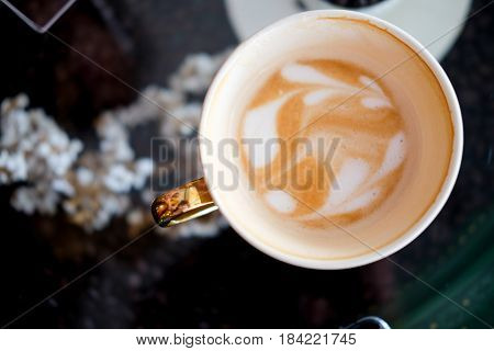 Hot fresh coffee in white cup espresso coffee top view
