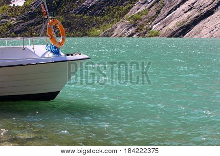 Boat In Pure Water Of Fjord