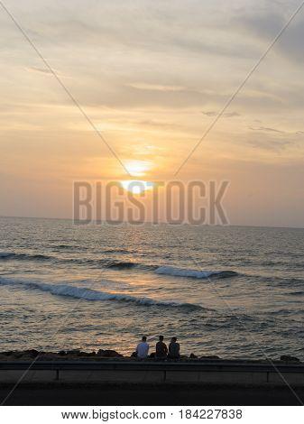 Group of friends watchin a caribean sunset