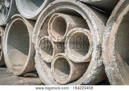 Stack of concrete drainage pipes prepare for underground construction.