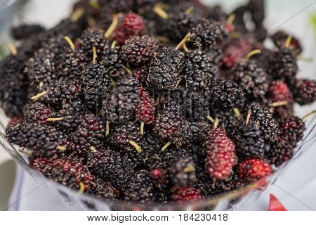 Closed up of fresh organic ripe mulberry.