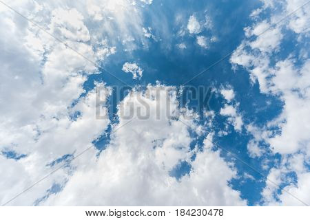 Vertical skyscape of blue sky background with clouds