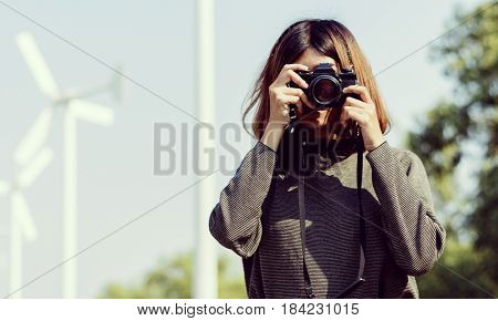 Woman Taking Snap Photo with Camera Wanderlust