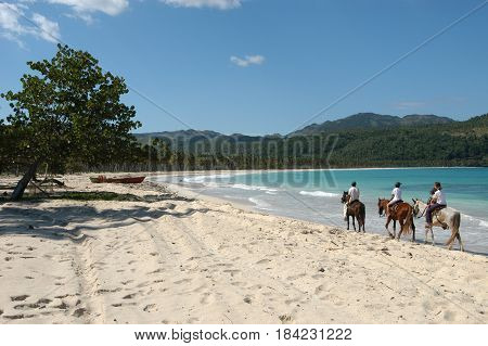 Las Galeras, Dominican Republic - 25 january 2002: people riding horses on the beach of Rincon near Las Galeras on Dominican Republic