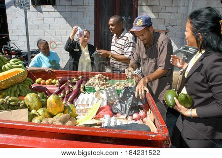 Street Seller Selling Food From His Car To People