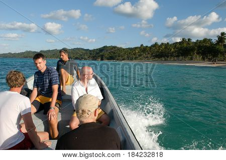 Las Galeras, Dominican Republic - 23 january 2003: tourists on a boat on the way to the beach of Rincon near Las Galeras on Dominican Republic