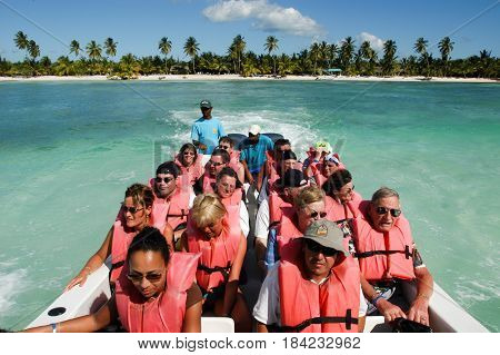 Saona Island, Dominican Republic - 1 February 2002: tourists on a boat on the way to the beach of Saona Island, Dominican Republic