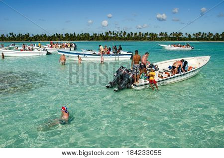 Saona Island, Dominican Republic - 1 February 2002: tourists swimming at the beach of Saona Island Dominican Republic