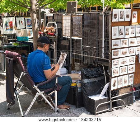 New York NY USA -- April 28 2017 -- An artist works on a drawing at his station on Fifth Avenue. Editorial Use Only.