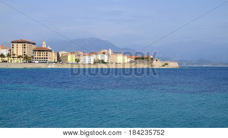Ajaccio cityscape with old typical houses beach and the sea with crystal water on the Corsica island France.
