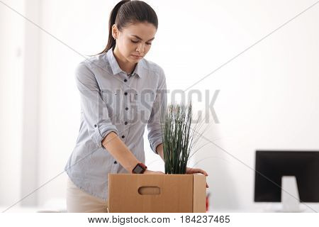 Gather things. Sad office worker being fired feeling bad while going to leave office