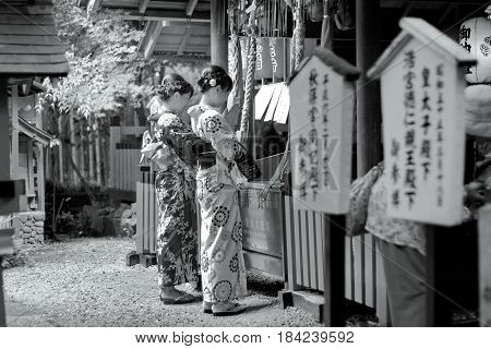 KyotoJapan-June 25Two women's kimonos respect belief by beautiful mind within shrine at Arashiyama on June 25 2016 in KyotoJapan. Selective focus at wowen.
