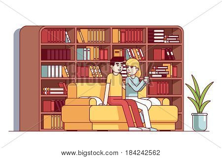 Young loving couple man and woman sitting flirting on sofa together. Home library living room with big bookcase full of books. Flat style cartoon vector illustration isolated on white background.