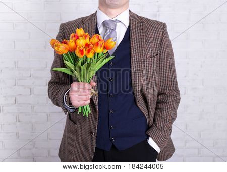 Women's Or Mother's Day Concept - Close Up Of Flowers In Male Hands
