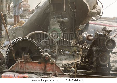 KOLKATA INDIA - APRIL 21 2017: Indian workers working at smoke covered project site. Black smokes coming out of diesel generator polluting environment . India is developing it's infrastructure.