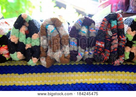Travel to Bangkok Thailand. The colorful plaids on a market.