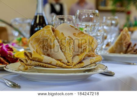 Empty glasses set with napkin in fine dining restaurant decorated decorated table in the restaurant