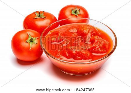 Small glass condiment bowl of red tomato sauce ketchup or puree. Isolated on white. Clipping path embeeded
