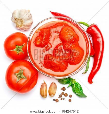 Small glass condiment bowl of red tomato sauce ketchup or puree. Isolated on white