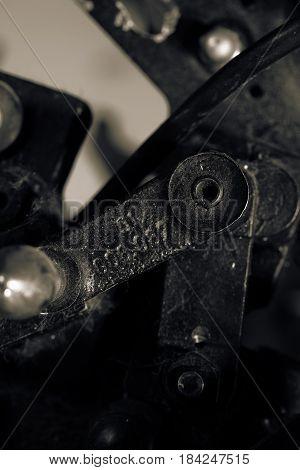 Old detail of obsolete industrial machine. Macro photo