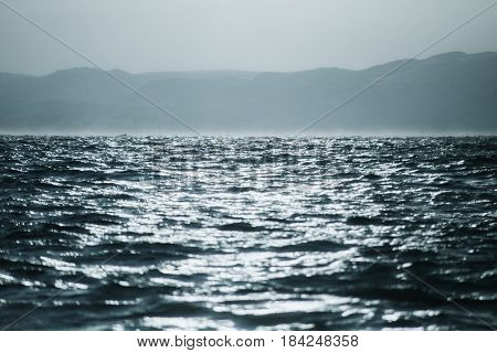 Abstract Water Texture Background. Sun Reflected On Water