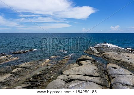 Ocean view and rock at the Tip of Borneo in Kudat, Sabah Borneo, Malaysia.
