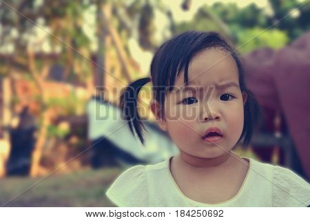 Closeup portrait mad young girl and angry little girl at home background.