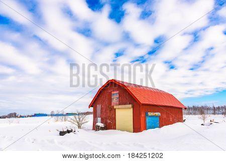 Bie, Hokkaido, Japan red barn in winter.