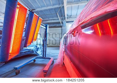 Auto body repair. infrared lamp in use