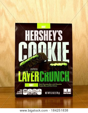 RIVER FALLS,WISCONSIN-APRIL 25,2017: A bag of Hershey's brand layer crunch cookie bars with a wood background.