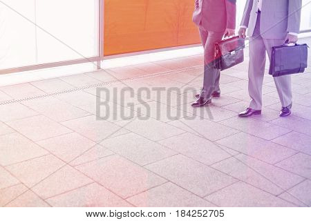 Low section of businessmen with briefcase walking in railroad station