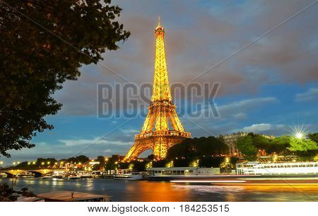 PARIS - 26 APRIL, 2017: Eiffel Tower in the Dusk on April 26, 2017. The Eiffel tower is the most visited monument of France.
