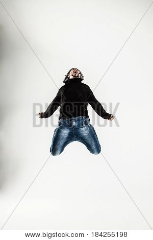 rapper dancing break dance .photo on a light background. the photo has a empty space for your text